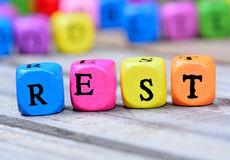 Rest word on table. Rest word on wooden table Stock Photo