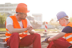 Rest during work. Two exhausted builders and rest during work Royalty Free Stock Photography