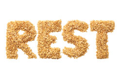 `Rest` written with oat grains word. Royalty Free Stock Photography