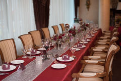 Restaraunt tables with red tablecloth. Red wedding decor, table of newly married stock photo