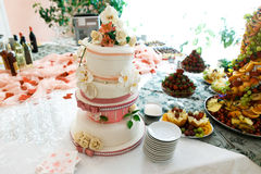 Restauant table with wedding cake and fruits Royalty Free Stock Photography