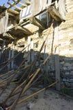 Restauración de la iglesia, madera y casas de la piedra en la provincia de Zam Foto de archivo libre de regalías