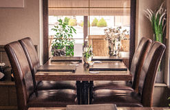Restauracja stół Z siedzeń I menu ` s Zdjęcia Royalty Free