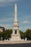 Restauradores fyrkant och staty, Lisbon, Portugal Arkivfoto