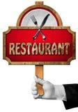 Restaurang - tecken med handen av uppassaren Royaltyfri Fotografi