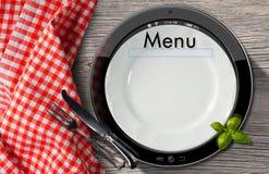 Restaurangmeny i minnestavladatoren Arkivfoto