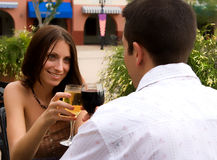 In the restaurant. Couple sitting in a restaurant, drinking wine royalty free stock photography
