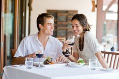 At Restaurant. A young couple sitting at a table at an outdoor restaurant