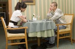 In the restaurant. Young couple in the restaurant Stock Images