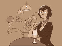 Restaurant. The girl with a drink at restaurant Stock Image