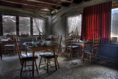 Restaurant abandoned dinner room. With red curtains Royalty Free Stock Images