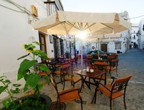 Restaurant alfresco. Tables and chairs outside a white-washed restaurant in Andalucia, Spain Stock Images