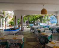 Restaurant on the Amalfi Coast. Beach front restaurant on the Amalfi coast with an interesting boat in the main restaurant itself Royalty Free Stock Photo