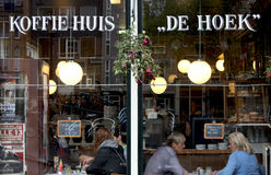 A restaurant in Amsterdam. People drinking and eating in a restaurant (coffee house), in Amsterdam, Netherlands Stock Image