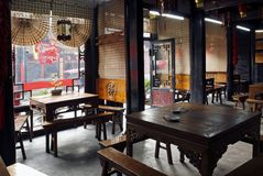 Restaurant in the ancient city. It keep by style in the past still at assign it indoors... Chinese characters on three pieces of baffle of both sides of indoor royalty free stock photos