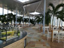Restaurant area at Therme Bucharest. Tables and chairs among the palm trees royalty free stock photos
