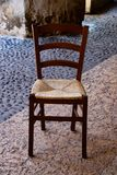 Old wooden chair. For restaurant or as a kitchen chair, living room or tavern, bars, b & b, pizzerias, agritourism, pubs, inns, wine bars, tasting rooms and for stock photography