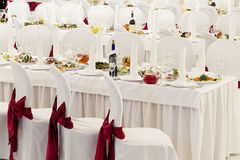 A restaurant banquet room decorated for a wedding Stock Images