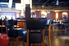 Restaurant bar. Empty restaurant bar with a contemporary atmosphere, selective focus on chair royalty free stock image