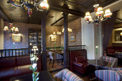 Restaurant bar interior. Vintage Restaurant and bar interiors in warm tones with wooden furniture, english pub stock photo