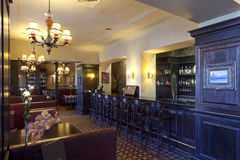 Restaurant bar interior. Vintage Restaurant and bar interiors in warm tones with wooden furniture, pub stock photography