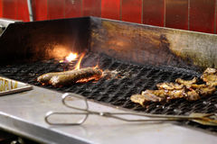 Restaurant bbq with meat on a flame grill Royalty Free Stock Image