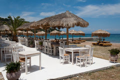 Restaurant on the beach in Greece Stock Photo