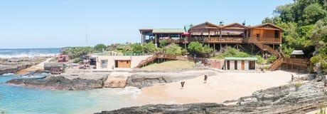 Restaurant, beach and small harbor Stock Photography