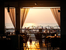 Restaurant on the Beach at sunset Stock Images