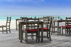 Restaurant on the beach with view over turquoise ocean Royalty Free Stock Photo