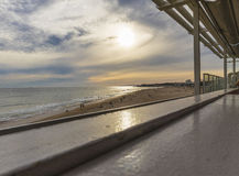 Restaurant bench overlooking the beach with sunset Royalty Free Stock Photography