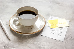Restaurant bill paying by credit card for coffee on stone table background Stock Images