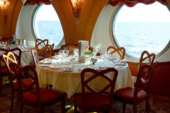 Restaurant on board a cruise ship ready for dinner Stock Photo