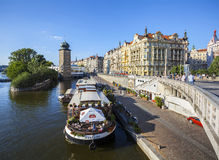 Restaurant on boat at the pier of Vltava river in old town of Prague. Royalty Free Stock Images