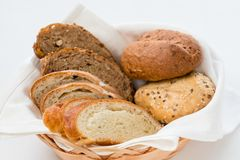 Restaurant bread serving hospitality basket. Restaurant bread serving. Hospitality concept. Basket with assorted pieces close up stock photography