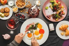Restaurant breakfast with bacon and fried eggs Royalty Free Stock Photo