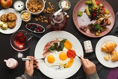 Restaurant breakfast with bacon and fried eggs Stock Photo