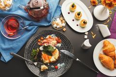 Restaurant breakfast with bacon and fried eggs Stock Images