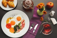 Restaurant breakfast with bacon and fried eggs Stock Photography