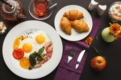 Restaurant breakfast with bacon and fried eggs Royalty Free Stock Photography
