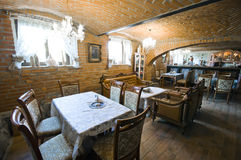Restaurant in brick basement Stock Image
