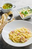 Restaurant business lunch menu, Pasta Carbonara, green salad and chicken soup. stock images