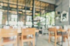 Restaurant cafe or coffee shop interior abstract blur background. Restaurant cafe or coffee shop interior with people abstract defocused blur background Stock Photos