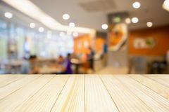 Restaurant cafe or coffee shop interior abstract blur background. Wood table with Restaurant cafe or coffee shop interior with people abstract defocused blur Stock Image