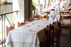 Restaurant on the canal Venice. table setting for a lovey dinner. Empty glasses set in cafe. Part of interior. napkins. Table setting for a lovey dinner. Empty Royalty Free Stock Images