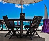 Restaurant chairs at ocean coast Royalty Free Stock Image