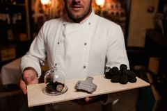 Restaurant chef delicacy. truffle food mushroom. Restaurant chef delicacy. truffle vegan food mushroom. waiter service meal concept royalty free stock images