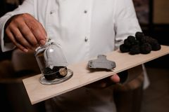 Restaurant chef delicacy. truffle food mushroom. Restaurant chef delicacy. truffle vegan food mushroom waiter service meal concept royalty free stock photography