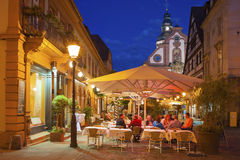Restaurant on the church place with Martins church in Ettlingen Royalty Free Stock Image
