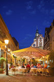 Restaurant on the church place with Martins church in Ettlingen Royalty Free Stock Photo